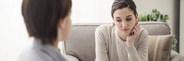 A young female talking to a therapist.