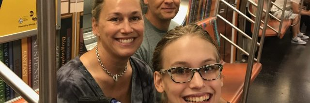 Sydney on a train with her parents.