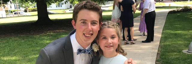 Tommy Shoemaker at a wedding with a young relative.