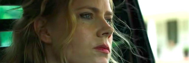 Amy Adam from the Sharp Object Trailer, sitting in her car looking forward
