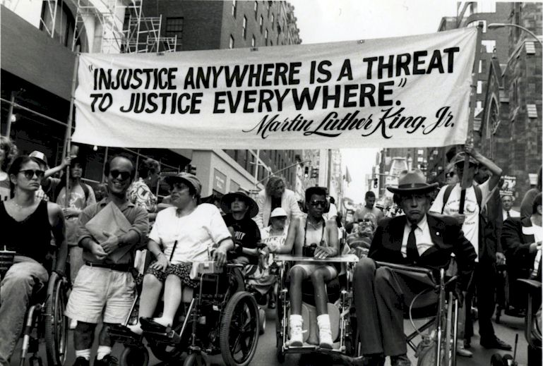 Justin Dart and disability rights leaders rally to pass the ADA.
