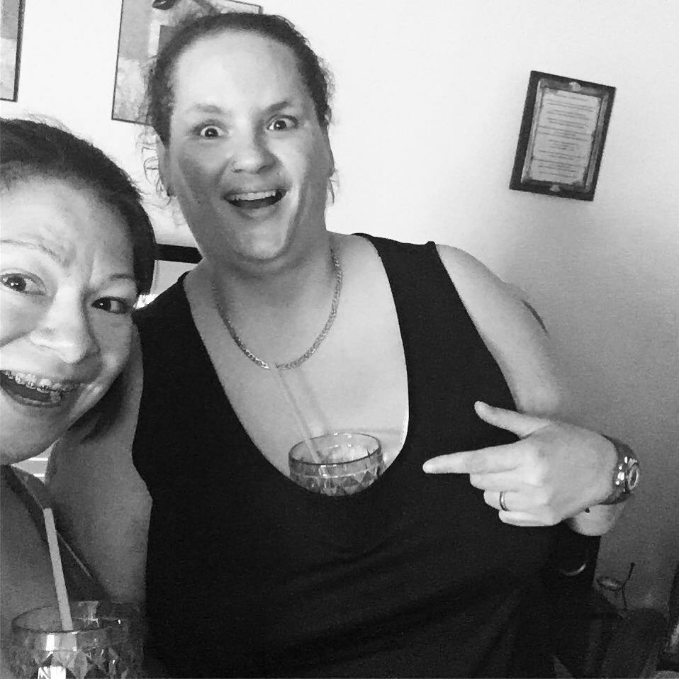 black and white photo of two friends laughing together