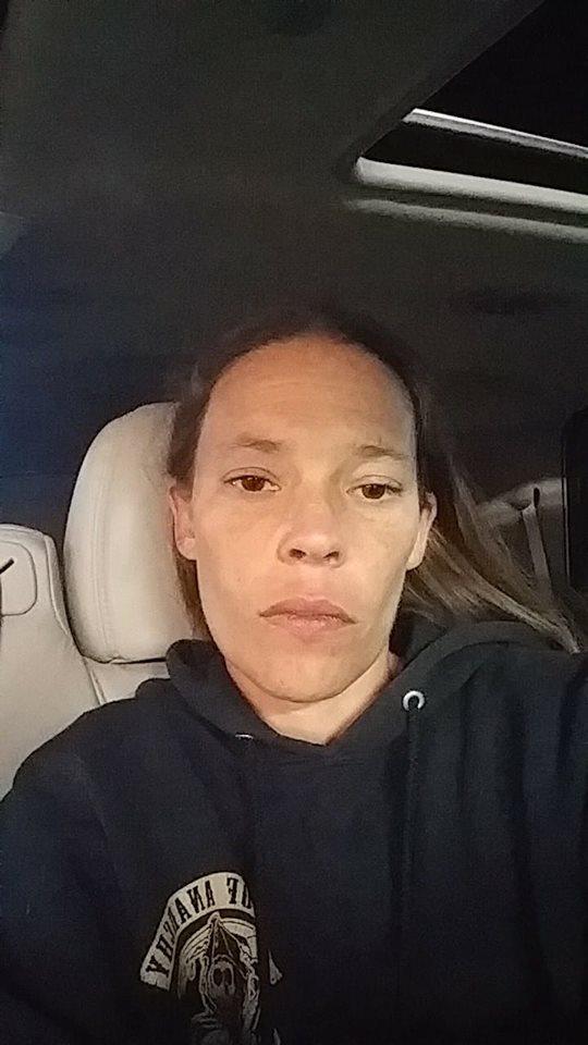woman taking a selfie in her car