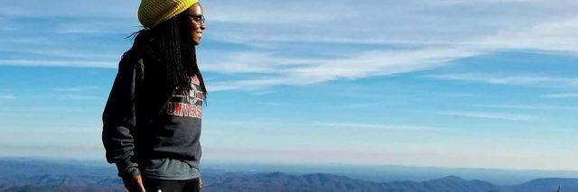 Kala standing on a mountain in Nigeria.