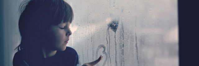 A young boy looking out a foggy window: 22 Things People With Anxiety Wish They Could Tell Their Younger Selves