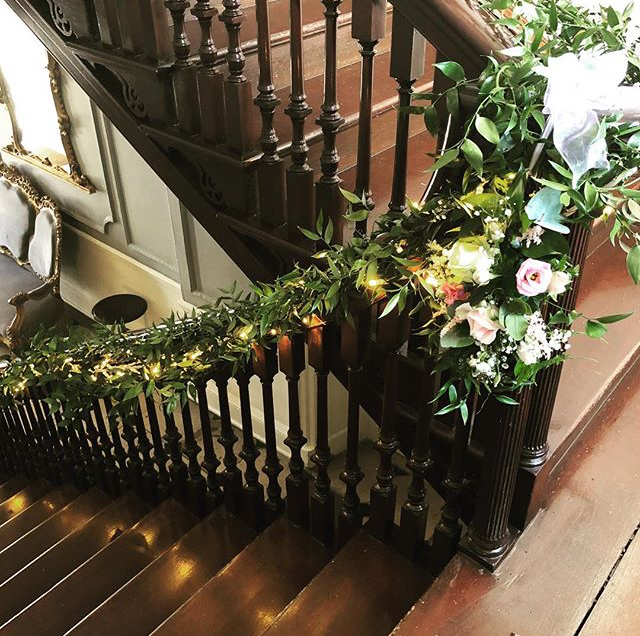 A picture of beautifully decorated stairs in the building.