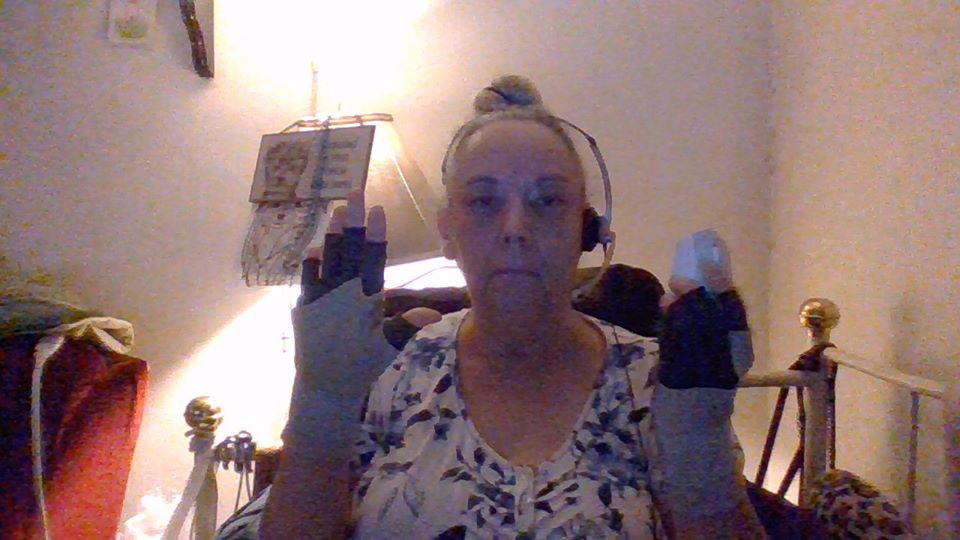woman wearing a headset and fingerless gloves