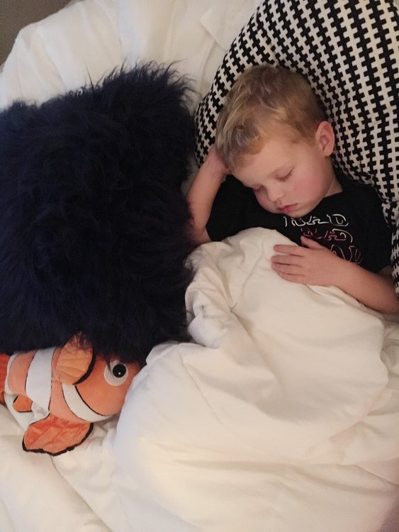 the author's boy snuggled in bed