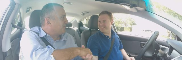 Steven in car with driving instructor