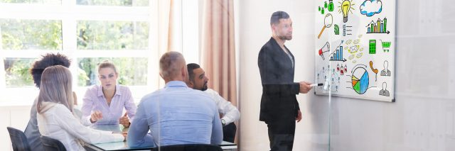 A picture of a group in a meeting.