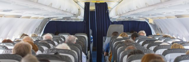 Commercial aircraft cabin with passengers.