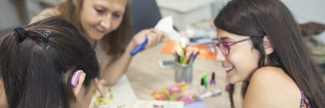 Art workshop including deaf student.