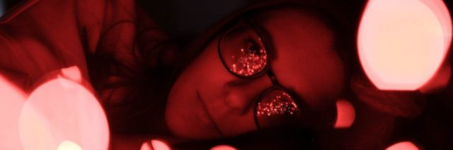 woman with light reflecting off her glasses