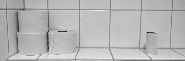 toilet paper on a bathroom shelf