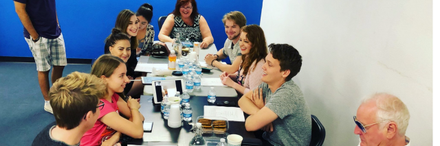 The cast of (Sorta) Supportive at a table read for the show.
