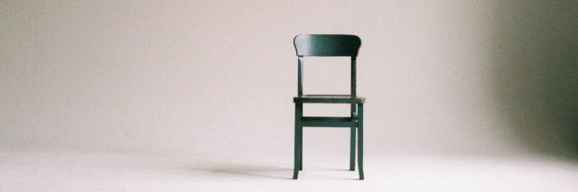 Empty black chair in empty room.