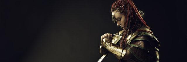 Warrior woman kneeling in prayer..