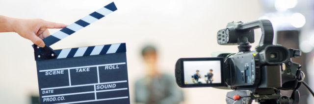 Movie camera and slate.