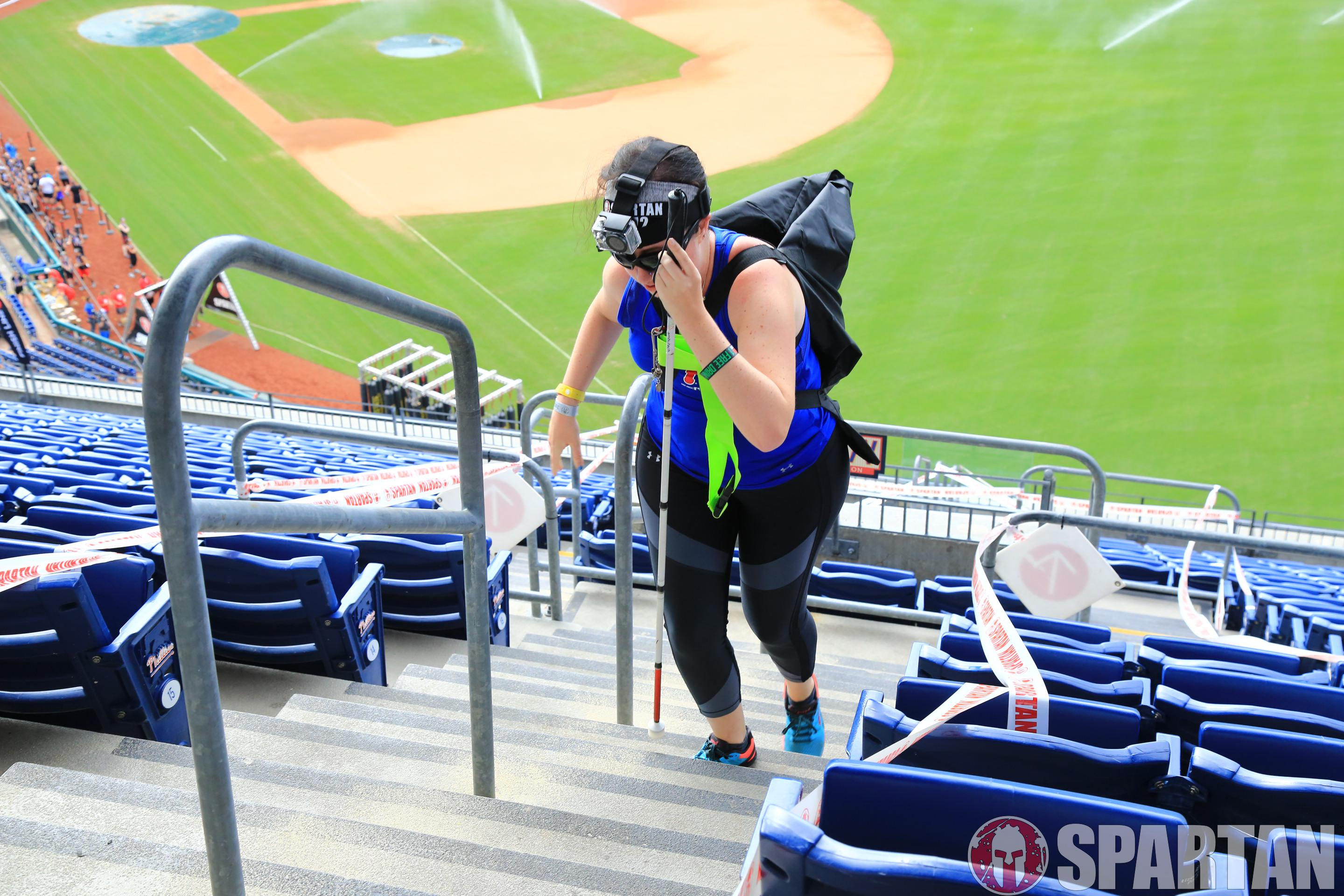 Jess competing in the Spartan at Citizens Bank Park with a modification for the sandbag carry.