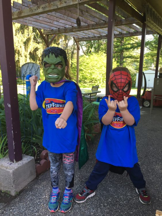 The author's two sons in superhero costumes and masks