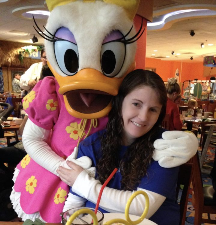 Woman with long brown hair and Daisy Duck at Disney Land