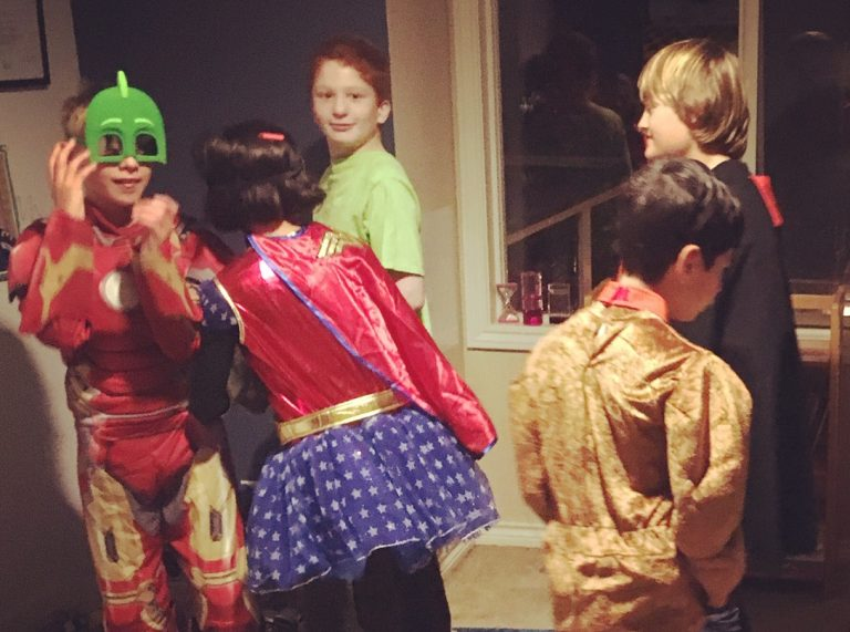 Nate with friends at Halloween.