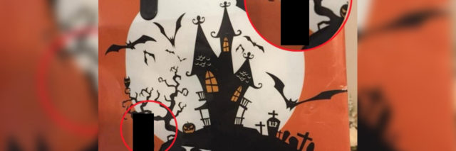 A trick-or-treaking bag with a haunted house