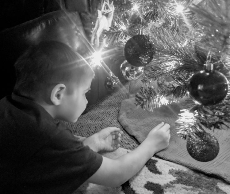 The author's child by the christmas tree