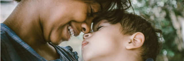 A mom looking adoringly at her son. Text reads: The 18 Hardest Parts of Being an Anxious Mama