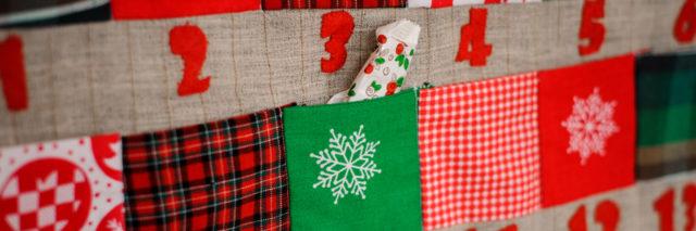 Christmas advent calendar with pockets on the wall.