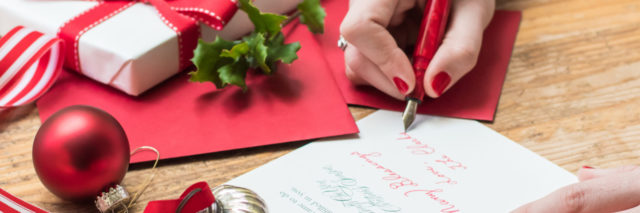 woman writing holiday letter