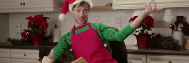 Zach Anner makes a gingerbread house.