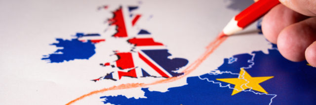 Hand drawing a red line between the UK and the rest of the European Union