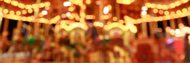 blurred merry-go-round lit up at night