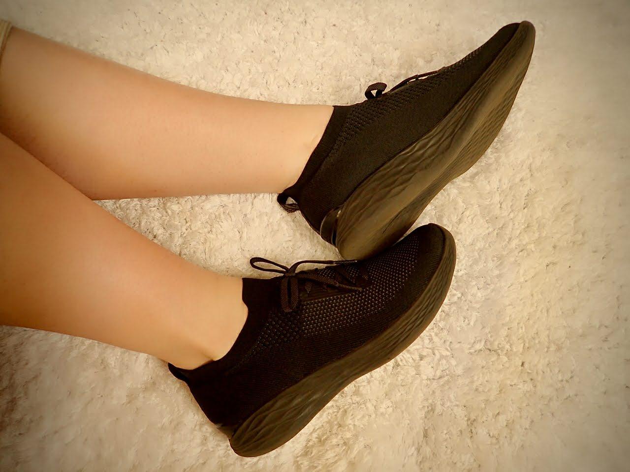 Skechers shoes in black.
