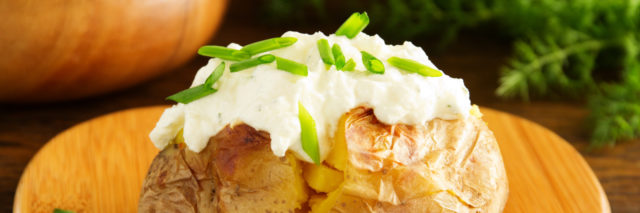 Baked potato with sour cream and chive.