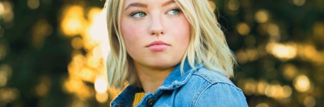 photo of blonde teen looking off camera with concerned expression