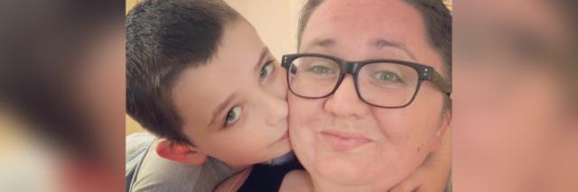 Selfie of son kissing his mom.