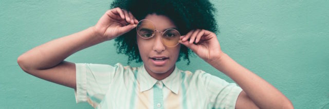 A woman with glasses, making a goofy face