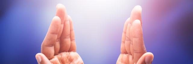 Hands holding light; spiritual healing.