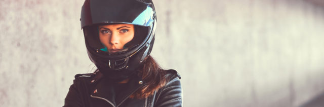 woman in leather jacket and helmet