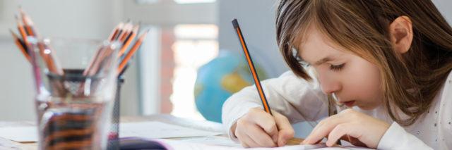 Young girl doing homework.