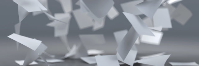 Sheets of paper flying in the wind.
