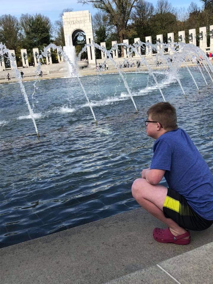 Alex looking at a fountain in Washington, D.C.
