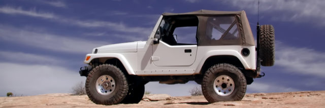 White Jeep on sand