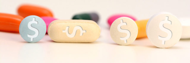 Health care cost concept with multicolored medical drugs with us dollar symbol