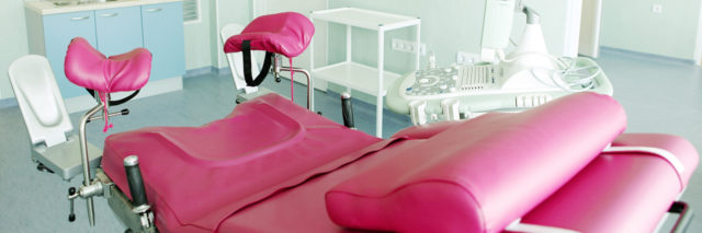 a pink gynecological chair