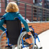 woman in a wheelchair on the pavement