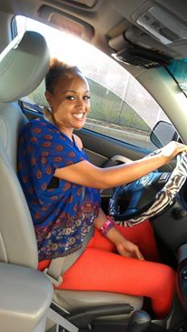 Keisha behind the wheel of her car when she used to drive.