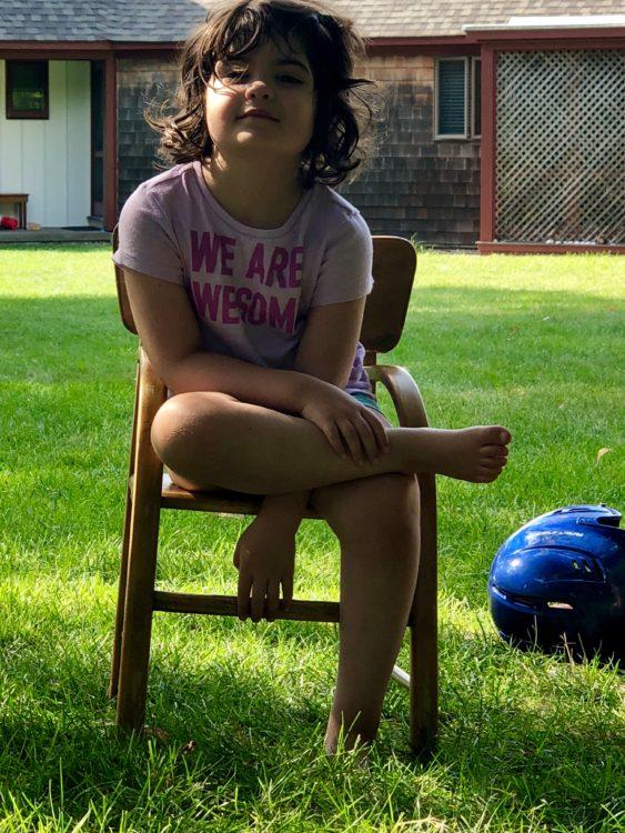susannah, sitting in a chair outside